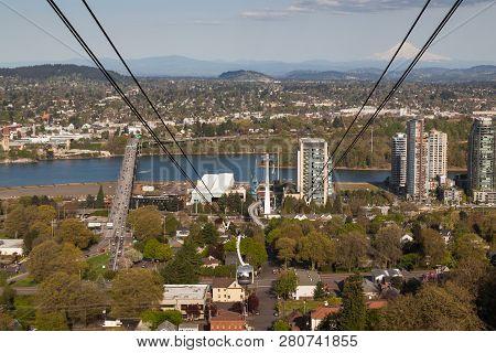 Portland, Oregon - April 14, 2014:  A Tram Car View Of City Buildings, Ross Island Bridge Crossing T