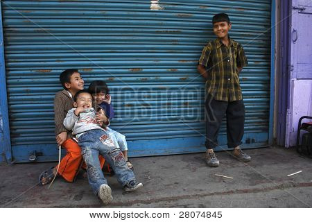 GANGTOK, INDIA - DECEMBER 5: Local children play near their house on December 85, 2008 in Gangtok, Indian. Gangtok is known as special place between Nepal, Bhutan and India, it's part of India, but with Tibet culture.