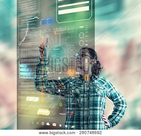 Woman  Using Futuristic Touch Screen Computer On A Colorful Bokeh Background