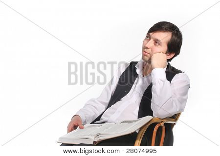 Pensive man with opened book