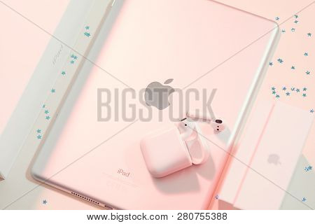 Kharkiv, Ukraine - December 5, 2018: Apple Ipad And Airpods. Mobile Technology And Wireless Connecti