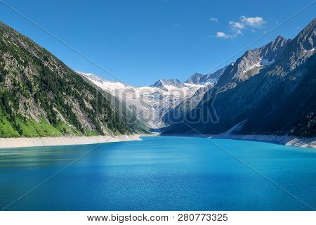 Mountain Lake In Austria. High Mountains Region At The Day Time. Natural Landscape In Austria Mounta