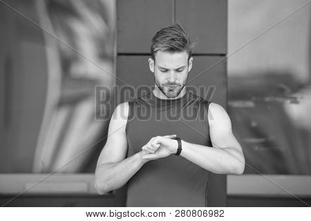 Set Up Route. Man Athlete Busy Face Check Fitness Tracker Urban Background. Athlete With Bristle Loo
