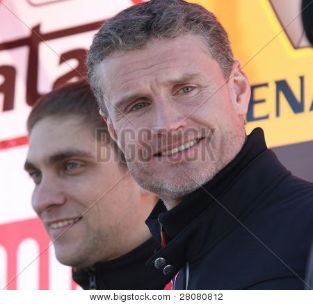 MOSCOW - FEBRUARY 23: Racing drivers Vitaly Petrov (L) and David Coulthard (R) during the 21st traditional
