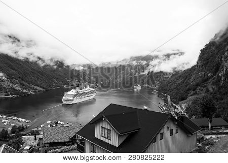 Geiranger, Norway - January 25, 2010: Travel Destination, Tourism. Ship In Norwegian Fjord On Cloudy