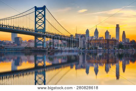 Philadelphia Sunset Skyline And Ben Franklin Bridge Refection From Across The Delaware River