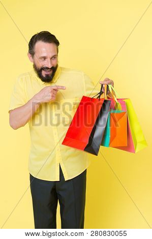 Shopping Happiness. Man Emotional Enjoying Shopping. Bearded Mature Man With Shopping Bag On Yellow