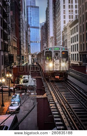 Chicago : October 10, 2018, Train On Elevated Tracks Within Buildings At The Loop, Glass And Steel B