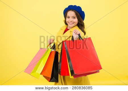 Small Girl Child With Shopping Bags. Birthday And Christmas Presents. Childrens Day. Big Sale In Sho