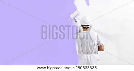 Painter Man At Work With A Paint Roller, Wall Painting Concept, Web Banner And Copy Space Template