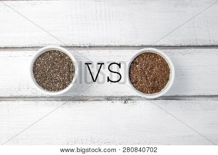 Small Bowl With Chia Seeds And Flax Seeds With Vs Sign Seen Directly From Above On Grey Background.