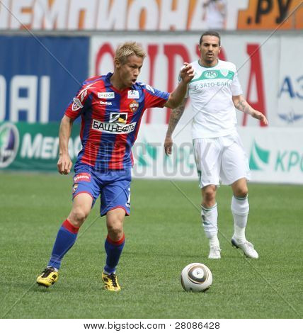 MOSCOW - MAY 10: CSKA's Keisuke Honda (L) in action during their team's Russian football championship game CSKA (Moscow) vs. Terek (Grozny) - (4:1), May 10, 2010 in Moscow, Russia.