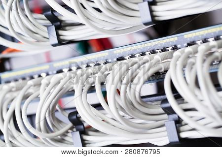 Gigabit Network Switch With Aligned Patch Cables In Datacenter