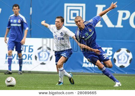 MOSCOW - JULY 3: Dynamo Moscow midfielder Igor Semshov (L) fnd Dynamo Kyiv defender Evgeniy Hacheridi (R) in the VTB Lev Yashin Cup: Dynamo Moscow vs.Dynamo Kyiv (2:0), July 3, 2010 in Moscow, Russia.