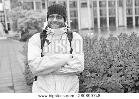 Tourist On Urban Background. Man Tourist Wear Warm Protective Clothes For Cold Climate Conditions. T