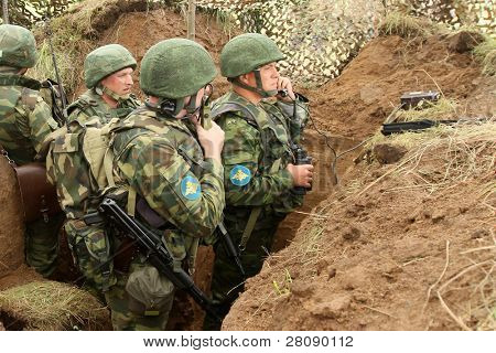 KOSTROMA REGION - AUGUST 26: Infantry soldiers in the dugout on the Command post exercises with 98-th Guards Airborne Division, August 26, 2010 in Kostroma region, Russia.