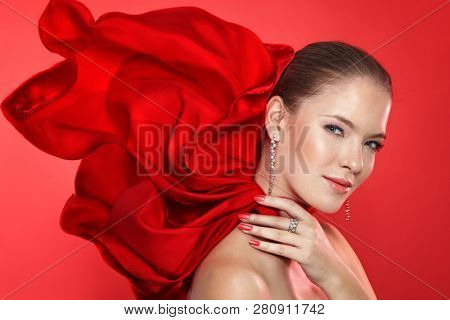 Lady in red scarf with diamod jewellry on red