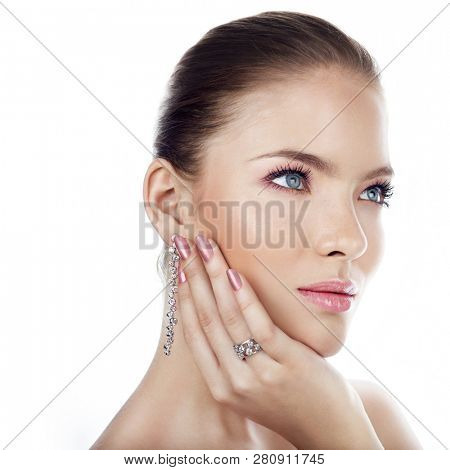 Woman with beautiful makeup wearing stylish jewelry. space for text.