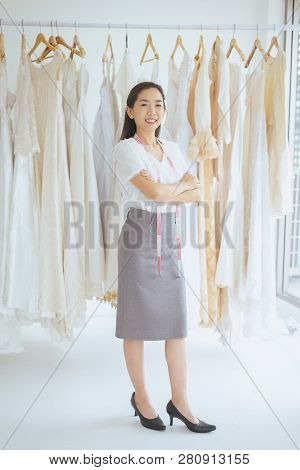 Portrait Of Asian Woman Wedding Dress Store Owner Standing And Cross Arm,beautiful Dressmaker In Sho
