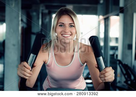 Woman Workout Cycling Exercise In Fitness Gym., Portrait Of Pretty Attractive Caucasian Woman Cyclin