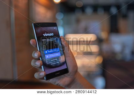 Chiang Mai, Thailand - June 09,2018: Man Holding Huawei With Vimeo On Screen. Vimeo Is A Video-shari
