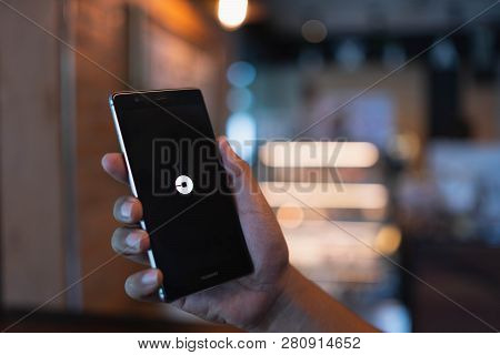 Chiang Mai, Thailand - June 09,2018: Man Holding Huawei With Uber Apps. Uber Is Smartphone App Trans