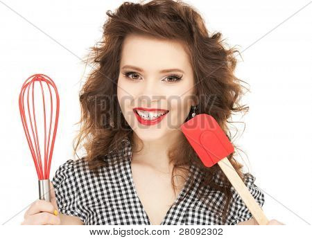 bright picture of lovely housewife with cooking eqipment.