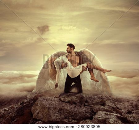 Fine art imagery. Woman and angel man embracing.