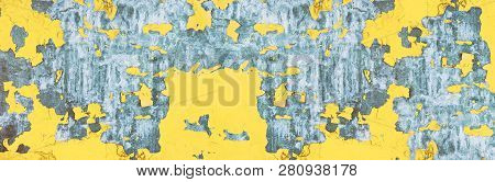 Wide Grungy Urban Background. Old Yellow Painted Iron Texture. Metal Surface With Peeling Cracked Pa
