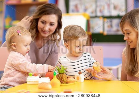 Babies Playing With Toys In Montessori School
