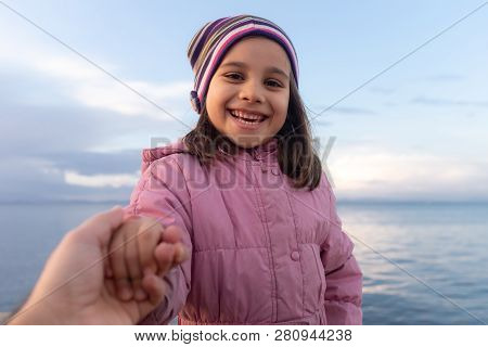 Happy Girl Portrait Outdoors At Seaside In Winter