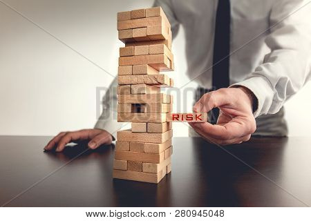 Taking Risk To Make Business Growth Concept With Wooden Blocks