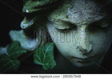 Beautiful Sad Angel. Portrait Of Ancient Statue. Fragment Of Sculpture. Religion, Faith, Death, Resu