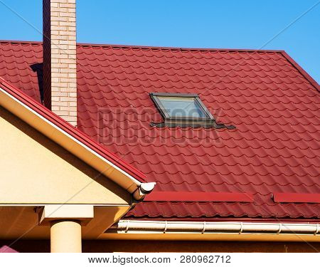 Skylight, Snowguard And Brick Chimney On Metal Tile Roof, Closeup