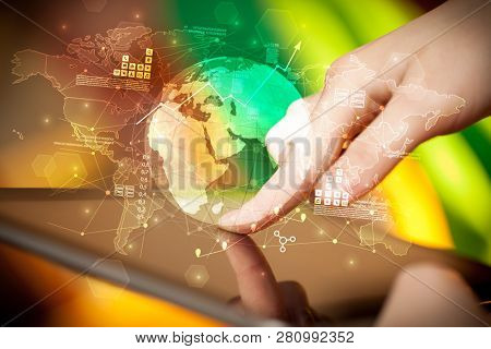 Hand using tablet with multinational worldwide estate report concept