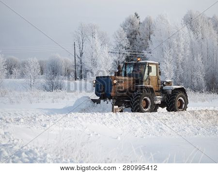 Tver Region. Sonkovsky District. Russia. 28 January 2019. Clearing Snow From The Road. Tractor Grade
