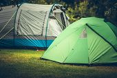 Summer Vacation Camping in a Tent. Campsite with Two Large Tents. poster