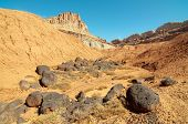 castle rock formation and volcanic boulders poster