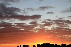 Colorful Sunrise With Clouds Above The City