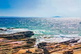 Beautiful sea horizon view and rocks on sunny day
