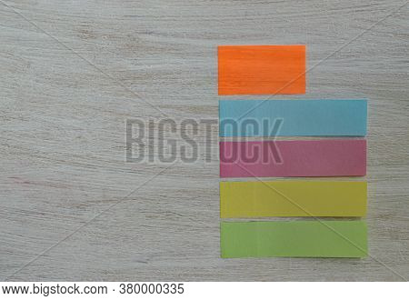 Stickers For Notes Bookmarks On A Textured Wooden Background