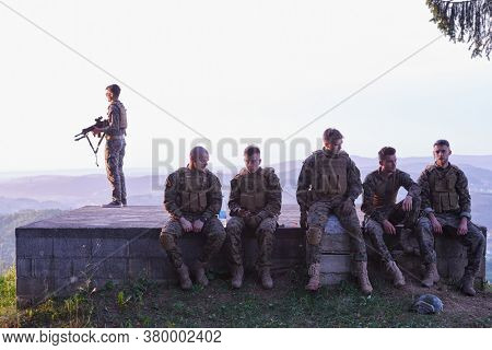 soldiers squad relaxing after battle having a break on training