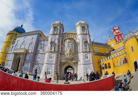 Sintra, Portugal - February 4, 2019: Exterior Front View Of The Pena Palace, Famous Colorful Castle
