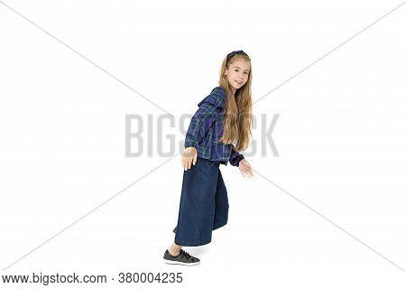Beautiful School Girl Is Having Fun, Running In Fashionable Blue School Uniform On White Background.