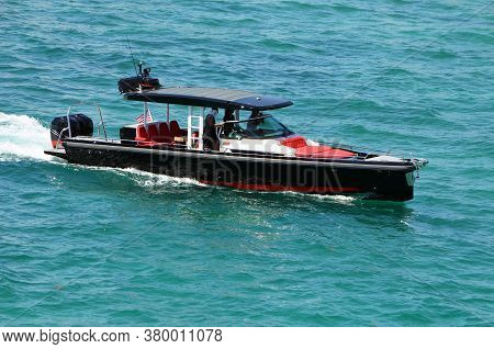 High-end Motor Boat Powered By Two Outboard Engines Cruising On Biscayne Bay Off Of Miami Beach,flor
