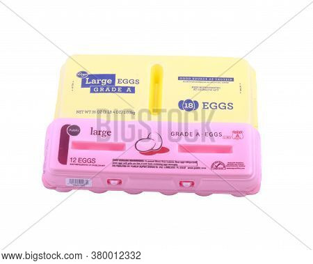 Yellow And Pink Styrofoam Egg Cartons Isolated On White