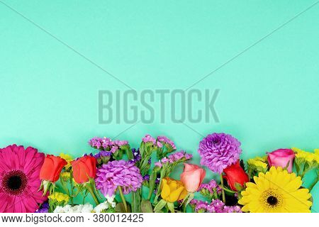 Floral Spring Background. Beautiful Flowers On A Turquoise Background. Floral Pattern With Petals On