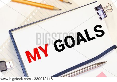 My Goals As Memo On Notebook With Many Light Bulbs