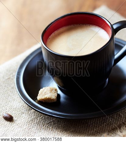 Cup Of Coffee On Linen Background. Close Up.