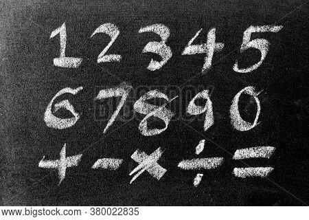 White Color Chalk Hand Drawing Of Number And Mathematics Symbol (plus, Minus Multiply, Divide And Eq